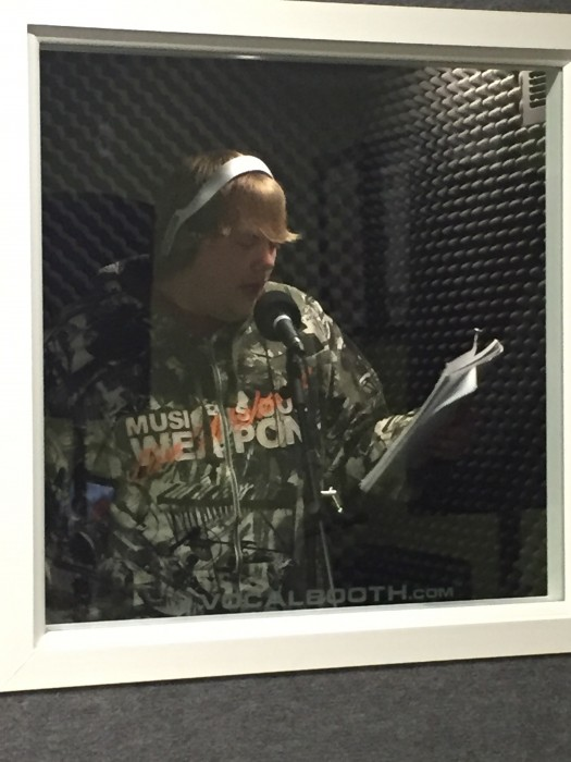 teen recording in the booth