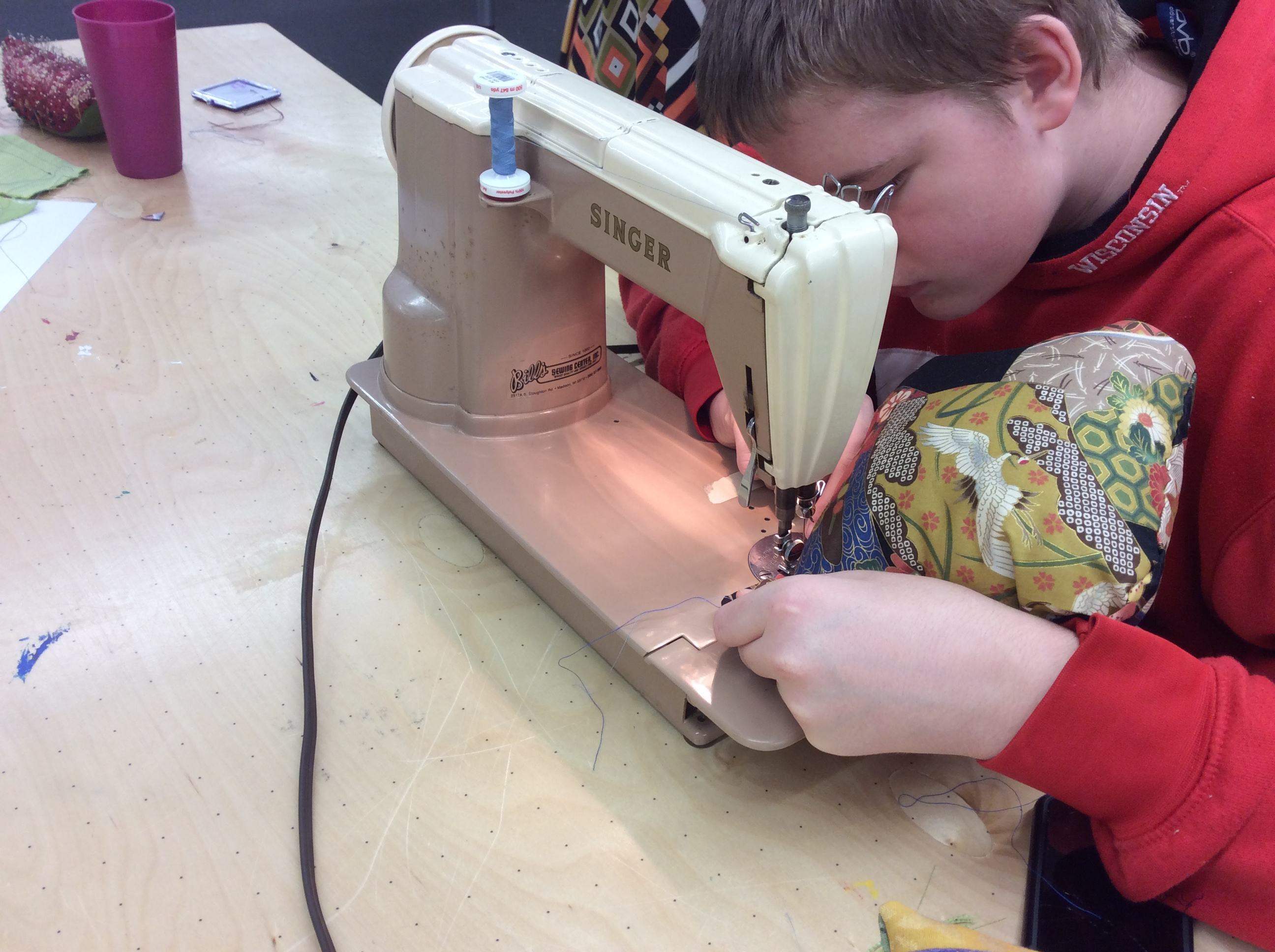 Bubbler Teen using sewing machine