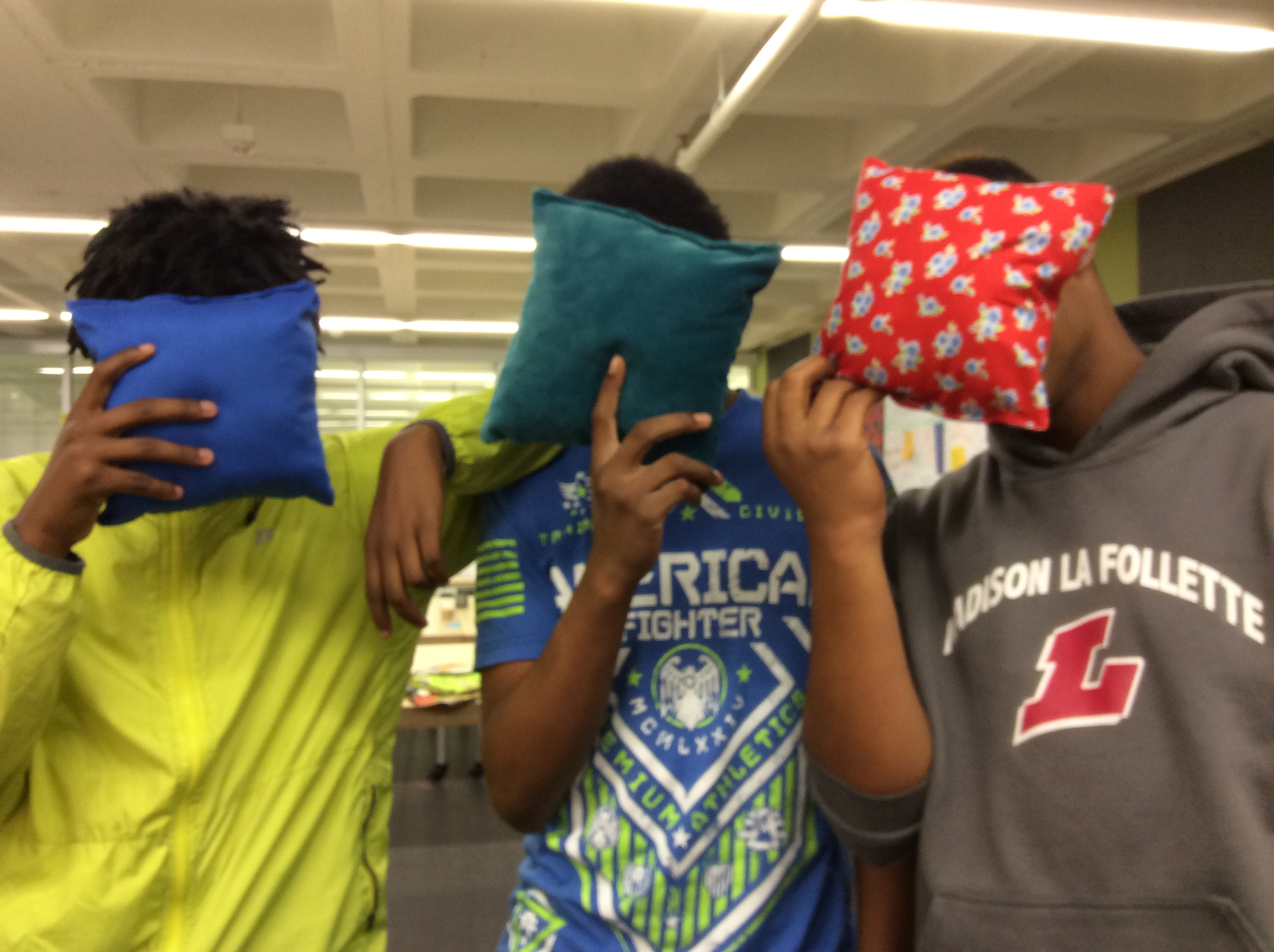 Bubbler Teens holding finished pillows