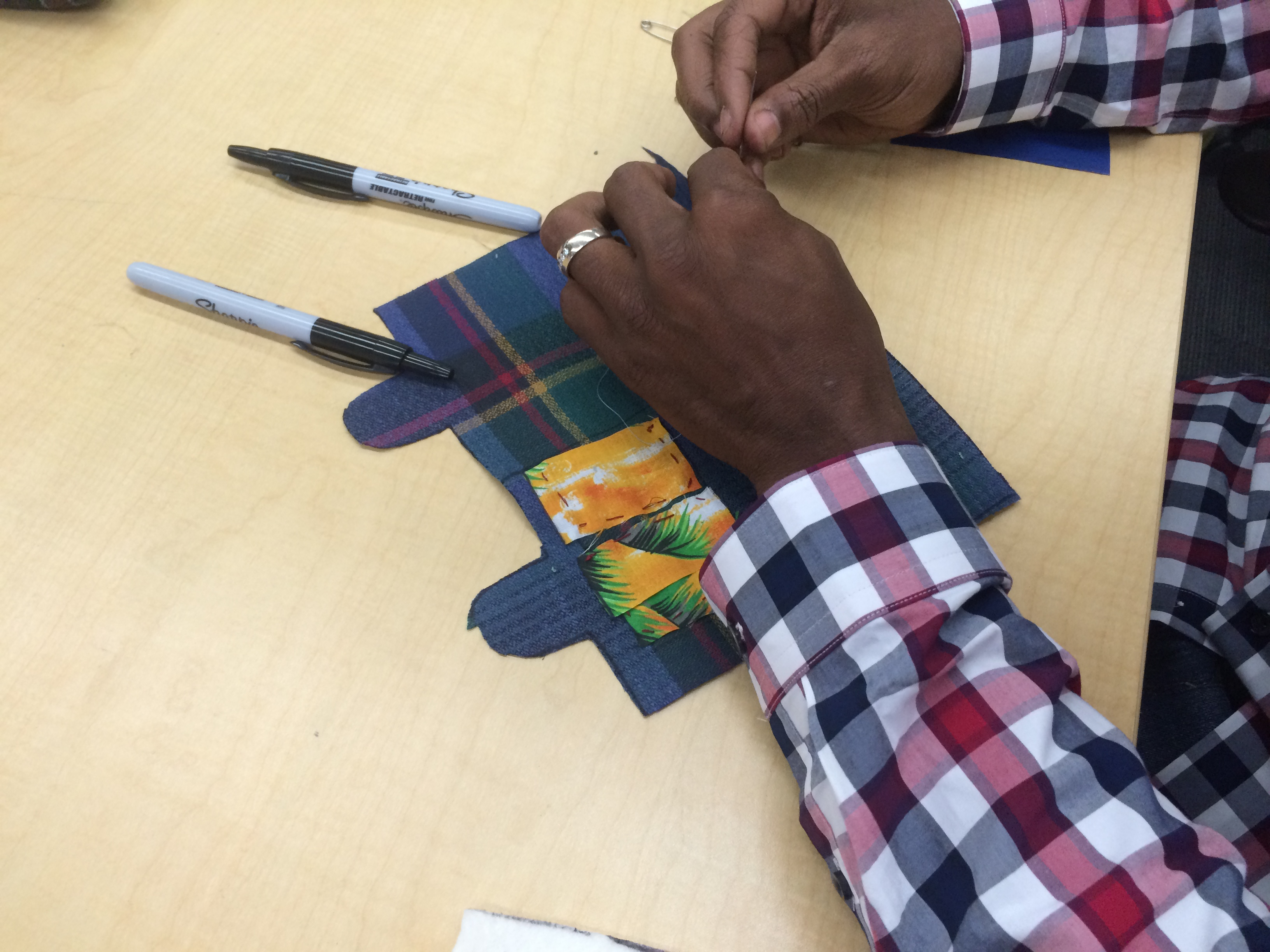 Hands creating sewing kit