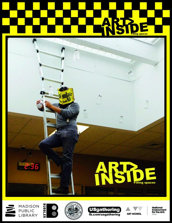 picture of artist Victor Castro on a ladder installing teen art piece at the detention center