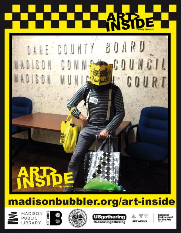Picture of artist Victor Castro sitting in front of the Madison Municipal Court sign