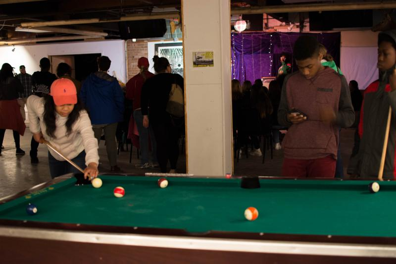 picture of teen playing pool at Air It Out teen art exhibition party
