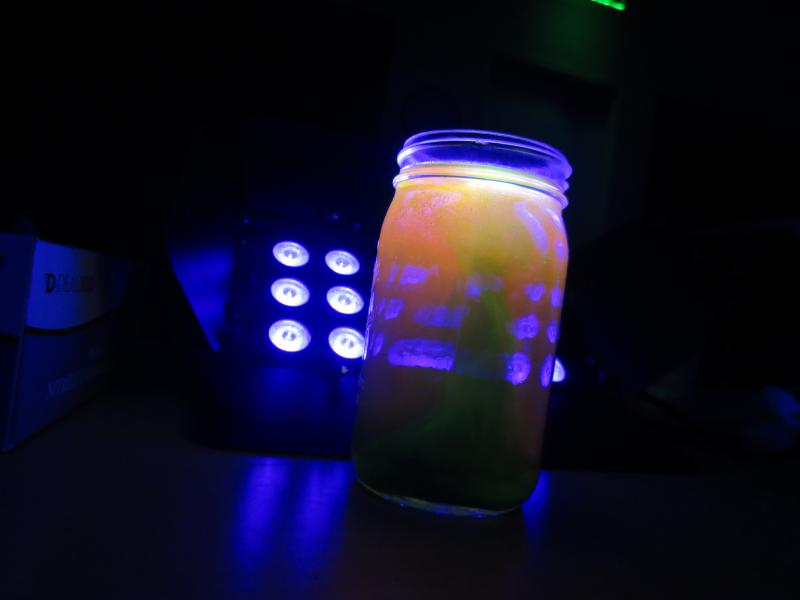 picture of black light reacting with jar of chemicals