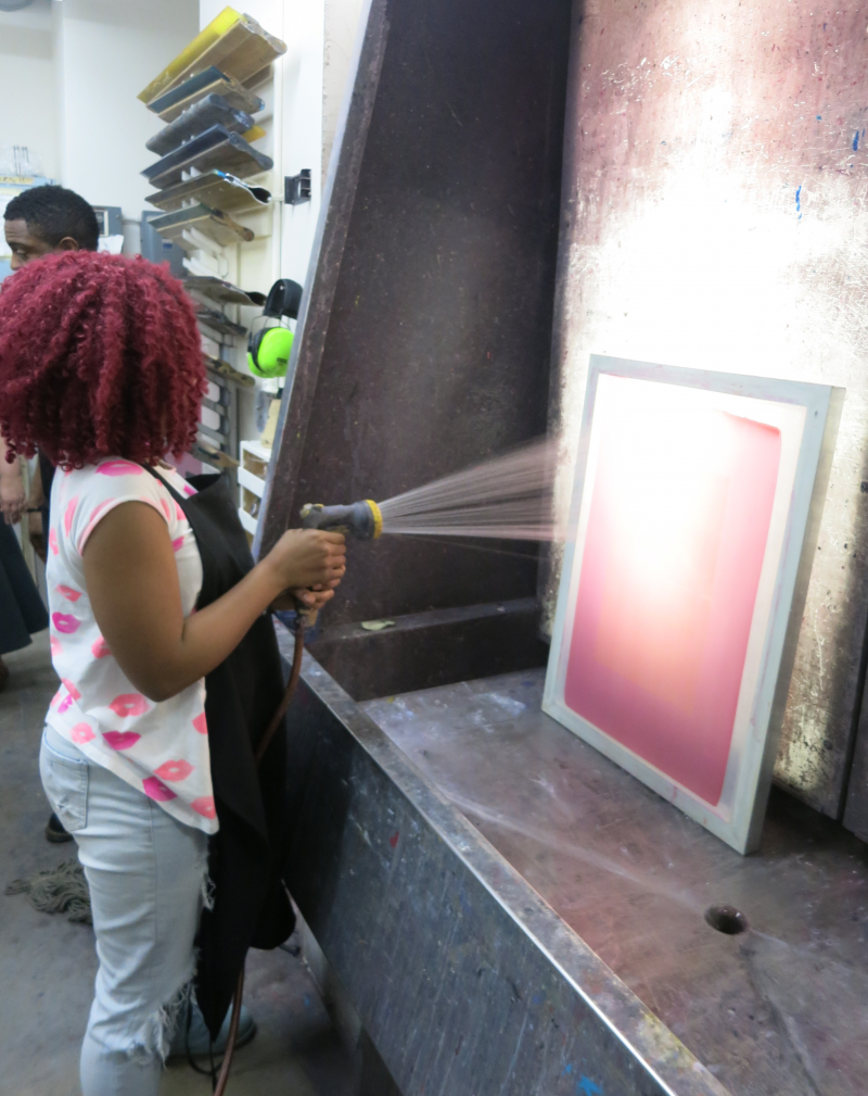 picture of teens screen printing during 15-week Air It Out semester