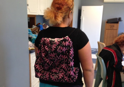 Teen wearing backpack she just created.