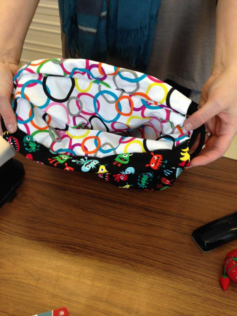 Teen showing reversible backpack she just created.
