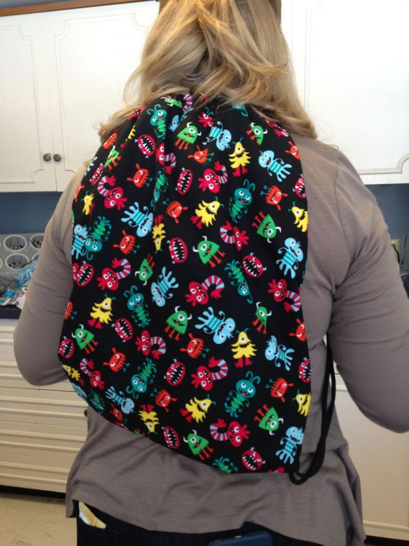 Wearing reversible backpack just created.