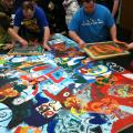 Picture of teens applying art with silk screens.