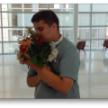 Picture of teen hugging a bouquet of flowers