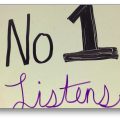 "Handwritten text reading ""No 1 listens"""