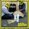 picture of teens working on an art piece made of plastic juice cups and clothespins